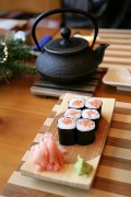 sushi and green tea being served at a Japanese restaurant