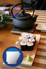 arkansas map icon and sushi and green tea being served at a Japanese restaurant
