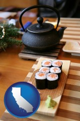 california map icon and sushi and green tea being served at a Japanese restaurant