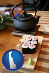 delaware map icon and sushi and green tea being served at a Japanese restaurant