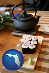 florida map icon and sushi and green tea being served at a Japanese restaurant