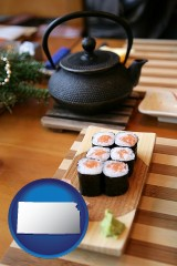 kansas map icon and sushi and green tea being served at a Japanese restaurant