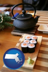massachusetts map icon and sushi and green tea being served at a Japanese restaurant