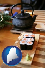 maine map icon and sushi and green tea being served at a Japanese restaurant