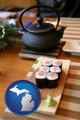 michigan map icon and sushi and green tea being served at a Japanese restaurant