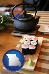 missouri map icon and sushi and green tea being served at a Japanese restaurant
