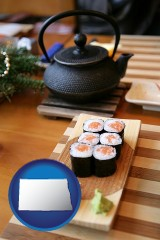 north-dakota map icon and sushi and green tea being served at a Japanese restaurant