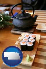 nebraska map icon and sushi and green tea being served at a Japanese restaurant