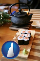 new-hampshire map icon and sushi and green tea being served at a Japanese restaurant
