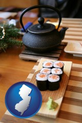 new-jersey map icon and sushi and green tea being served at a Japanese restaurant