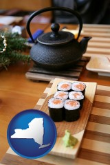 new-york map icon and sushi and green tea being served at a Japanese restaurant