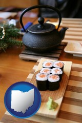 ohio map icon and sushi and green tea being served at a Japanese restaurant