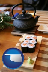 oklahoma map icon and sushi and green tea being served at a Japanese restaurant