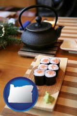 oregon map icon and sushi and green tea being served at a Japanese restaurant