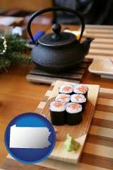 pennsylvania map icon and sushi and green tea being served at a Japanese restaurant