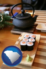 south-carolina map icon and sushi and green tea being served at a Japanese restaurant