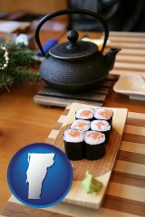 vermont map icon and sushi and green tea being served at a Japanese restaurant