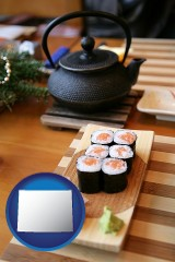 wyoming map icon and sushi and green tea being served at a Japanese restaurant