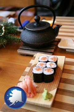 sushi and green tea being served at a Japanese restaurant - with Alaska icon