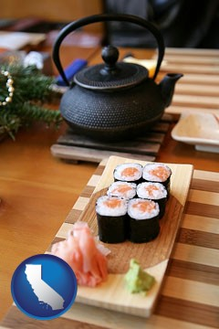 sushi and green tea being served at a Japanese restaurant - with California icon