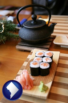 sushi and green tea being served at a Japanese restaurant - with Washington, DC icon