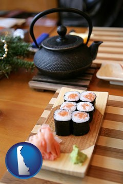 sushi and green tea being served at a Japanese restaurant - with Delaware icon