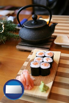 sushi and green tea being served at a Japanese restaurant - with Kansas icon
