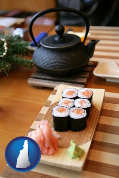 sushi and green tea being served at a Japanese restaurant - with New Hampshire icon
