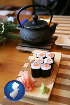 sushi and green tea being served at a Japanese restaurant - with New Jersey icon