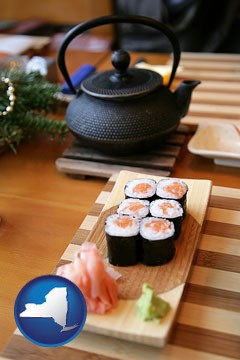 sushi and green tea being served at a Japanese restaurant - with New York icon