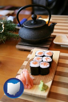 sushi and green tea being served at a Japanese restaurant - with Ohio icon