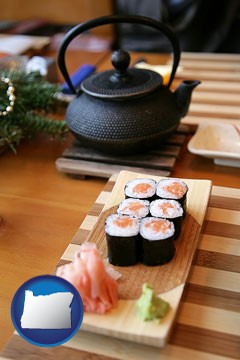 sushi and green tea being served at a Japanese restaurant - with Oregon icon