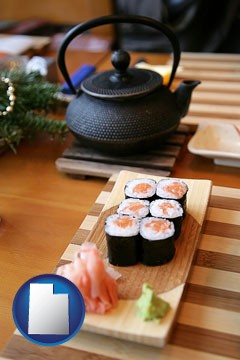 sushi and green tea being served at a Japanese restaurant - with Utah icon